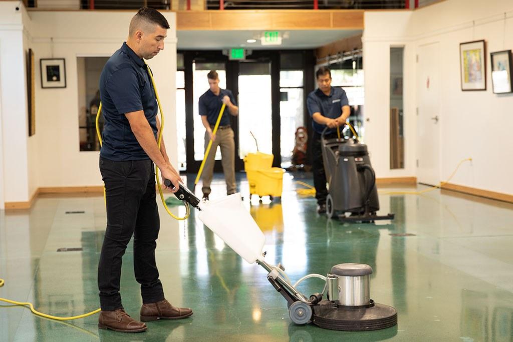 Image of advanced crew polishing floor
